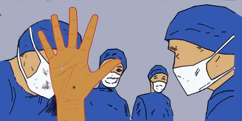 Eine Hand stoppt ein Operationsteam